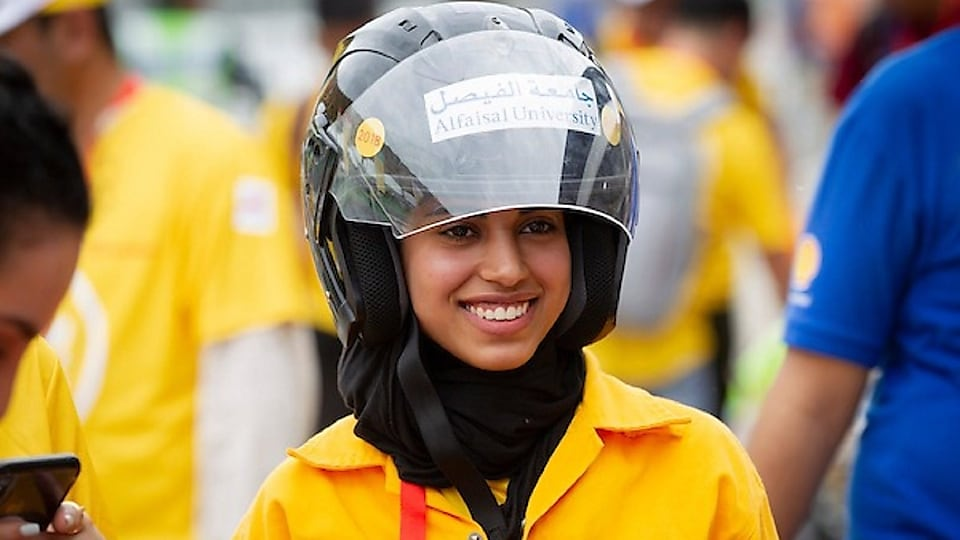 girl in yellow with helmet smiling